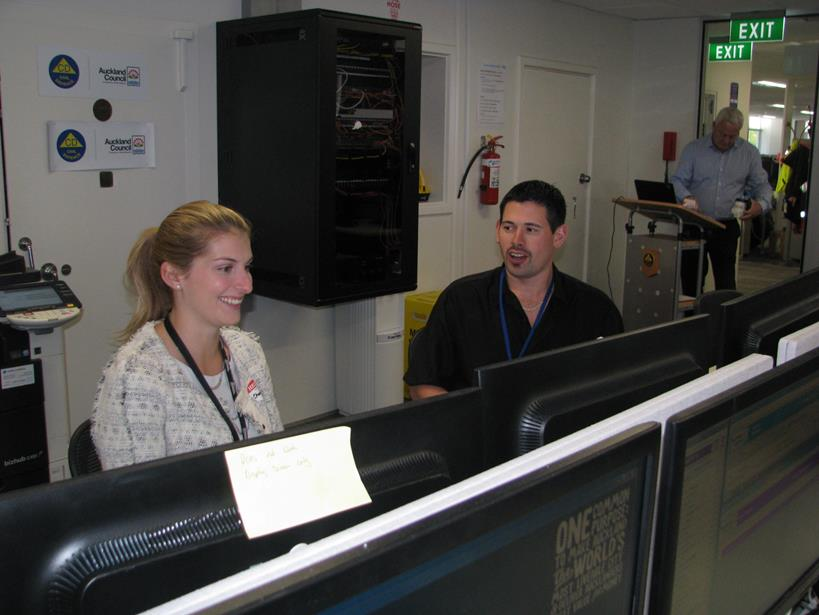 Hamish Keith, Planning and Intelligence Advisor, coaches Chantelle Subritzky (ACES) on the Planning and Intelligence desk during a recent exercise.