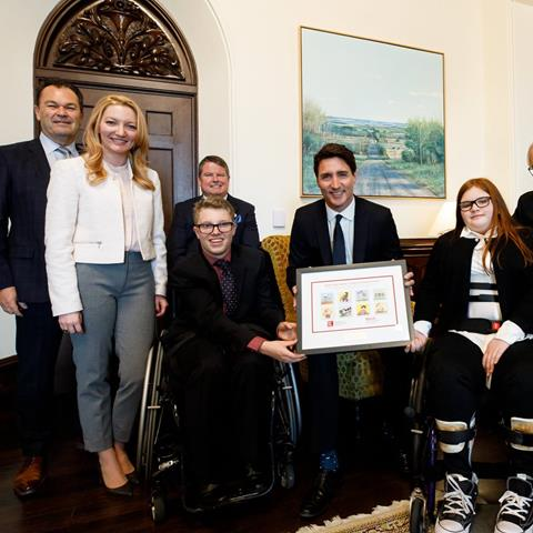 Photo of Easter Seals staff and ambassadors with Prime Minister Trudeau