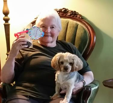 Photo of Sidney Wait with her dog on The FriendShip's 5th birthday