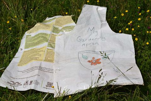 A recycled compost bag turned into an apron.