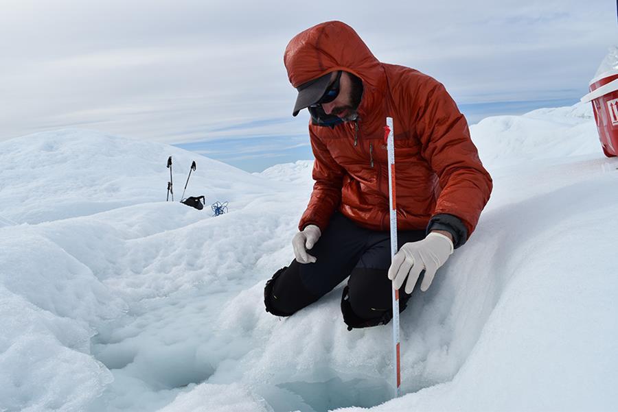 Marco Tedesco measures a cryoconite in the Greenalnd ice sheet (Kevin Krajick)