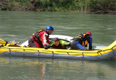 Three men in a raft on a river.