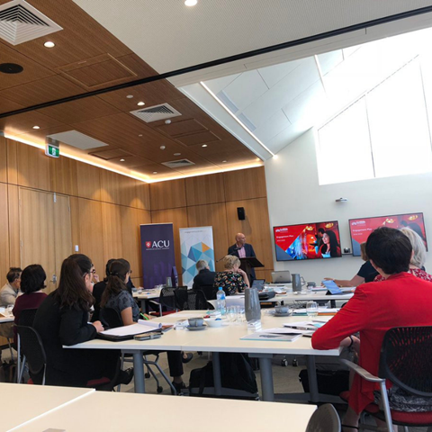 Image via @profSCJones - Symposium Room with Speaker