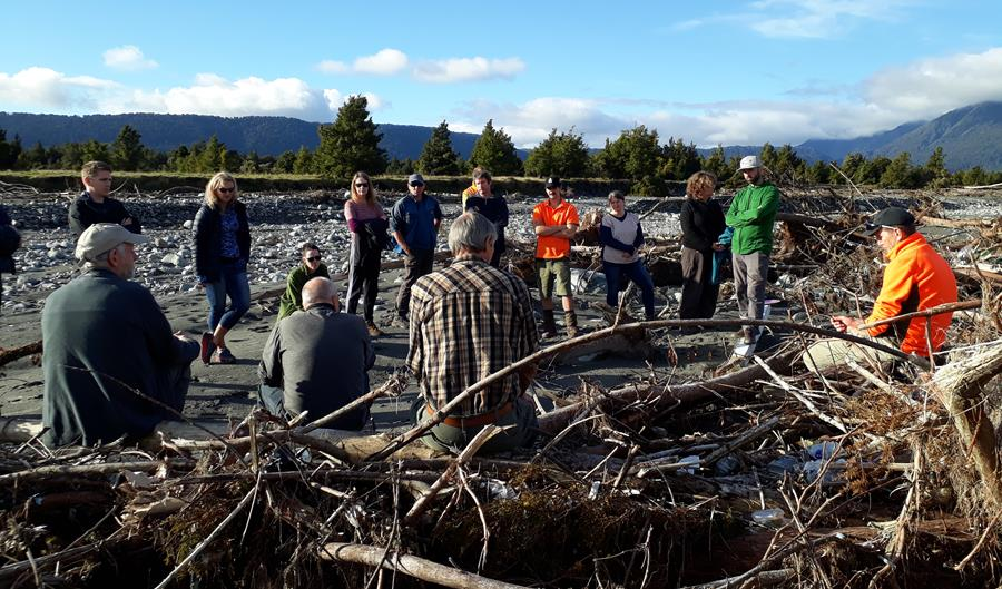 Board Members and DOC staff in the Fox Riverbed observing the Landfill outfall.
