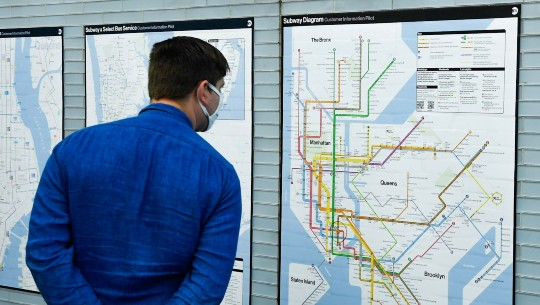 A commuter examines the new subway diagram.