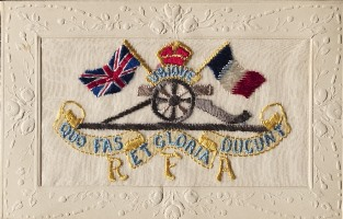 Image of Front of A postcard embroidered with the badge of the Royal Artillery surmounted by a British and a French flag