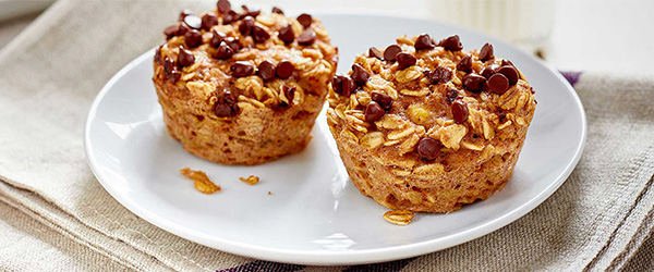 Photo of oatmeal chocolate chip muffins on white plate