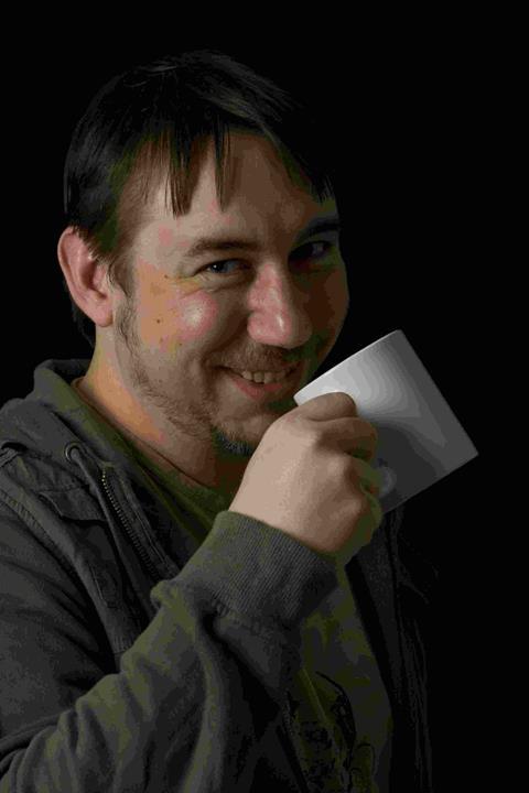 Gav drinking a cup of tea