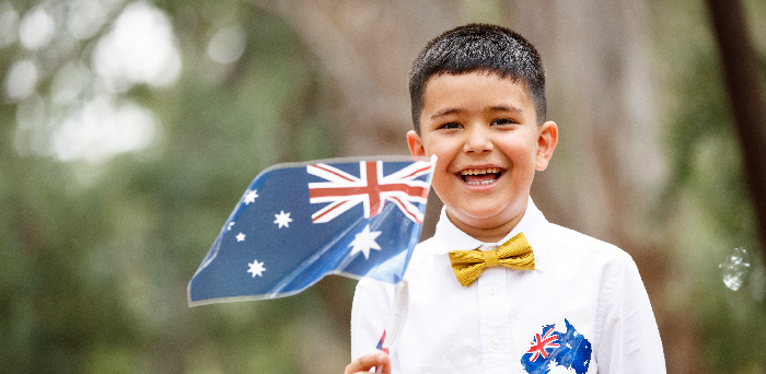 Boy waving Australian flag