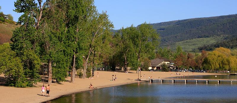 Summer revellers take in the sun on Kal Beach in the North Okanagan.