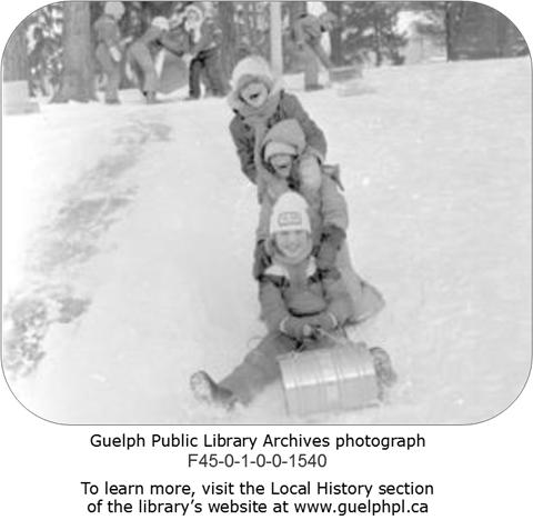A photograph from the Library's Archives collection featuring a bunch of kids tobogganing.