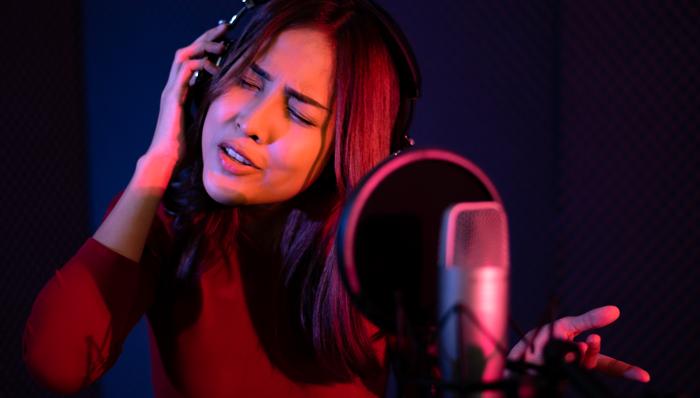Girl singing in a recording studio
