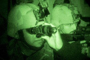 An Iraqi Army soldier (left) scans the area with night vision equipment during a night exercise at the Taji Military Complex, Iraq. Defence