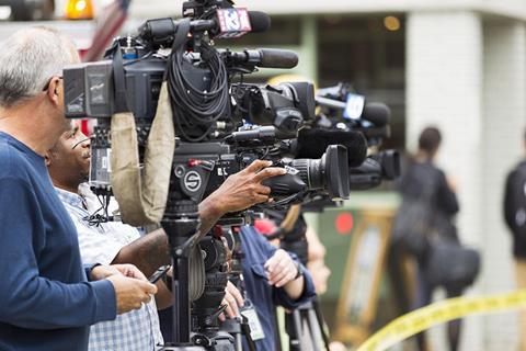 Media cameras waiting.