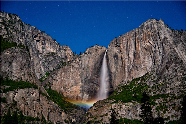 A moonbow is captured in the spray of Yosemite Falls in May 2013.