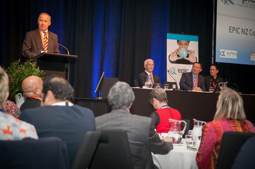 Plenary speakers, Tenby Powell (standing), Sir George Fistonich, Wei Gao and Traci Houpapa (sitting)