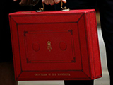Image of the red budget suitcase being held by the Chancellor
