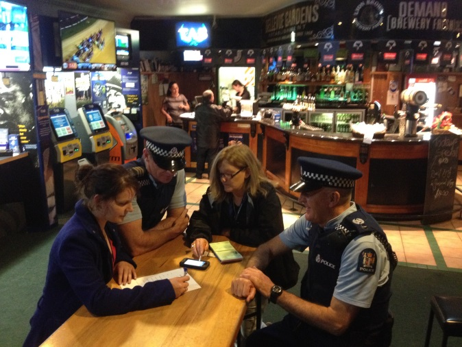Police officers and people at bar