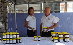 Stall owners with honey jars