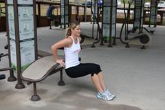 Female using fitness exercise equipment
