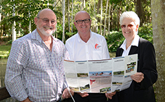 Cr McDonald, APLNG and Council staff look over the new parks brochure.