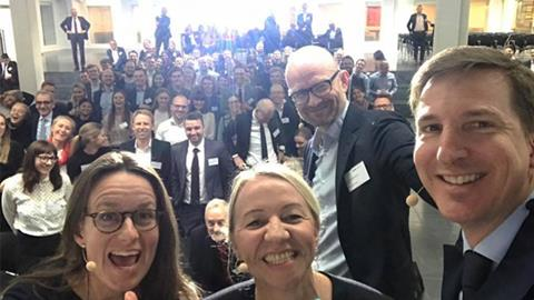 One of the three debaters took this 'panel debaters and moderator with a backdrop of pure talent' selfie.