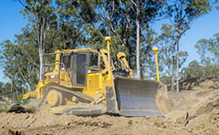 Photo of bulldozer preparing a development site