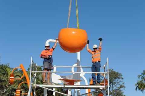 Workers installing big tipper bucket