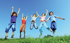 Photo of children jumping for joy