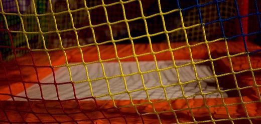 Indoor trampoline viewed through a net