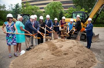 Elected officials shoveling dirt for the groundbreaking