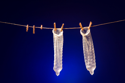 Condoms hanging on a clothes line