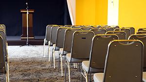 Rows of chairs at a seminar