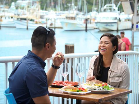 Couple enjoying seafood in Port Stephens