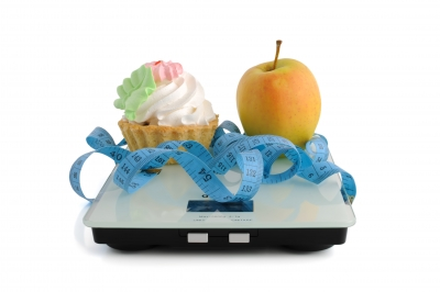 Cake and apple on scales