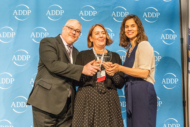 Representatives from ADDP present Heather Dextradeur with the 2018 Manager Award