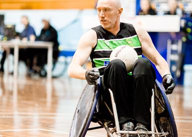 A man playing wheelchair rugby