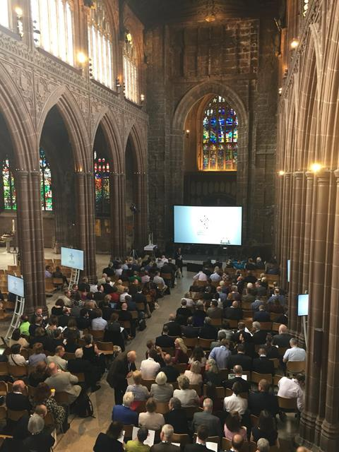 Photo of people gathered in the Cathedral looking towards the St Mary Window