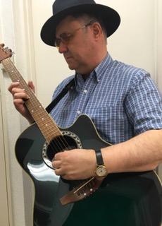 Photo: Russ Palmer playing guitar