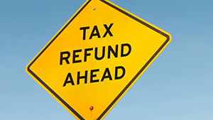 Yellow sign saying tax refund ahead
