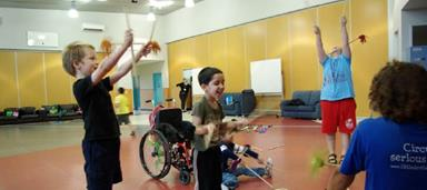 Children playing with circus instruments
