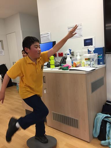 Boy learning gymnastics