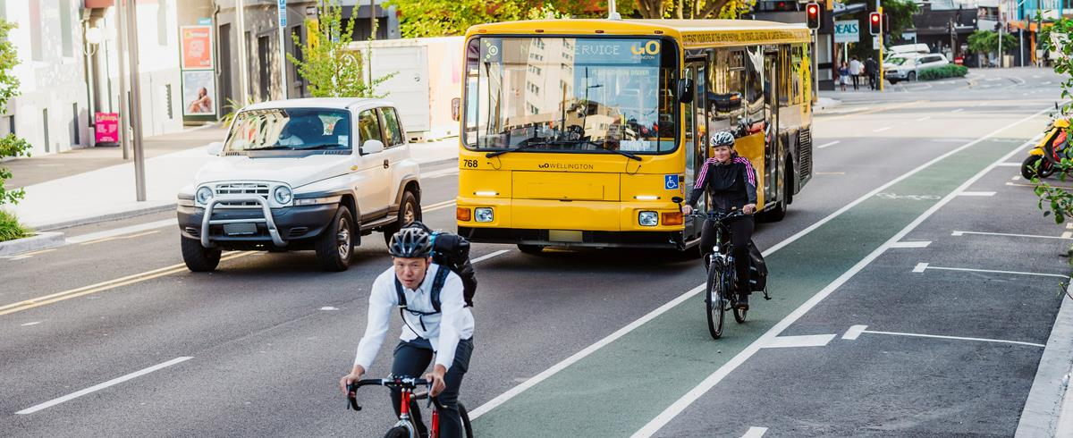 bike lanes with cyclists, a bus and a car