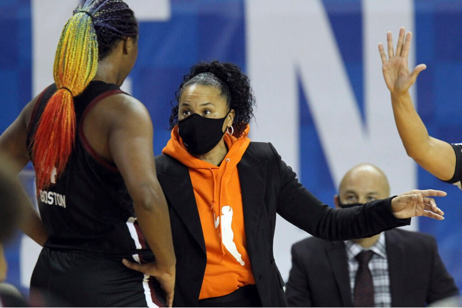 South Carolina head coach, Dawn Staley coaching with mask on during college basketball game