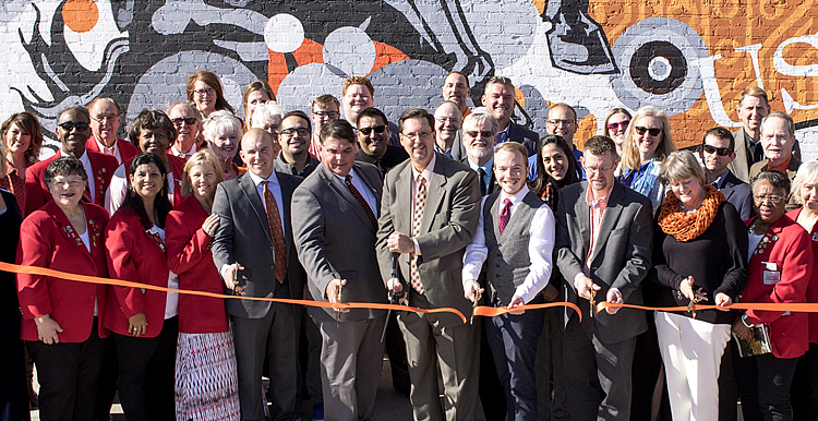 Members of the community celebrate GOPO opening
