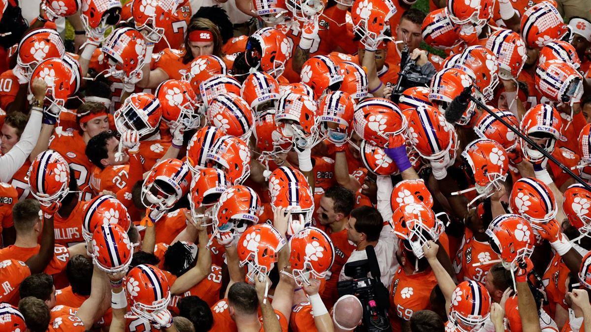 Clemson Tigers football team raising helmets