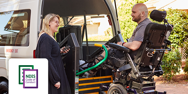 Wheelchair user being helped into a transport van.