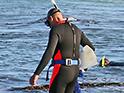 Abalone fisher wearing a wetsuit
