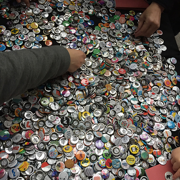 Browsing our 1331-strong button badge collection.