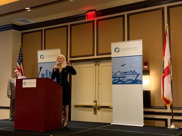 Sharon Bock speaking at podium